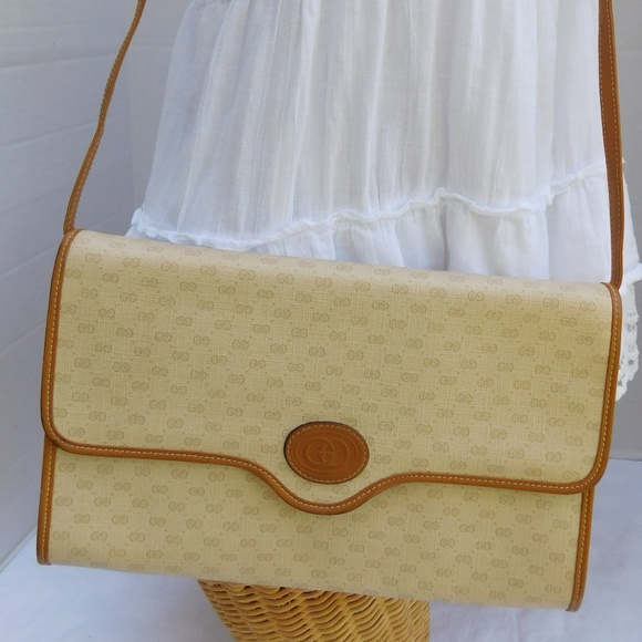 06d9a9ada0a6 Gucci Handbags - Vintage Gucci Cream Tan GG Convertible Clutch